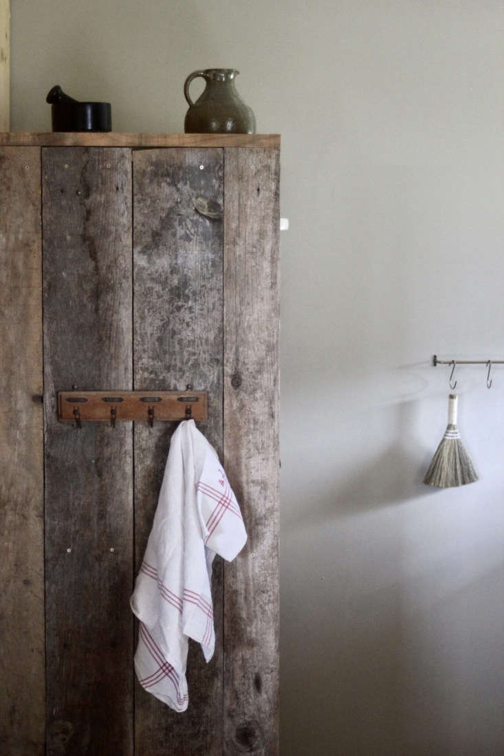 Jean built the food cupboard from weathered old wood. The painted walls downstairs are in Farrow & Ball Drop Cloth.