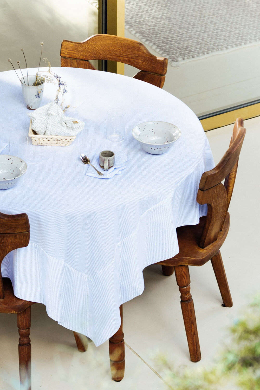The blue-striped Jack Tablecloth is available in three different sizes, starting at €src=
