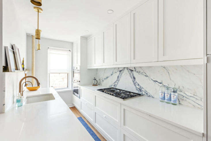 "Nest Fine Interior Contracting this galley kitchen in Jackson Heights, Queens. The homeowner says, ""During the job they  reached out several times to see how it was going. If I'd had any challenges with my contractor, which I didn't, I knew they were there to advise and help me out."""