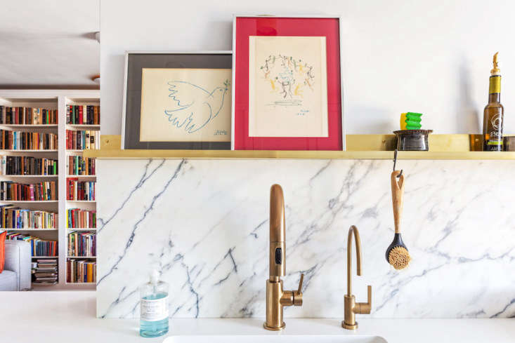 a closeup of the brass delta faucet in the jackson heights renovation. 15