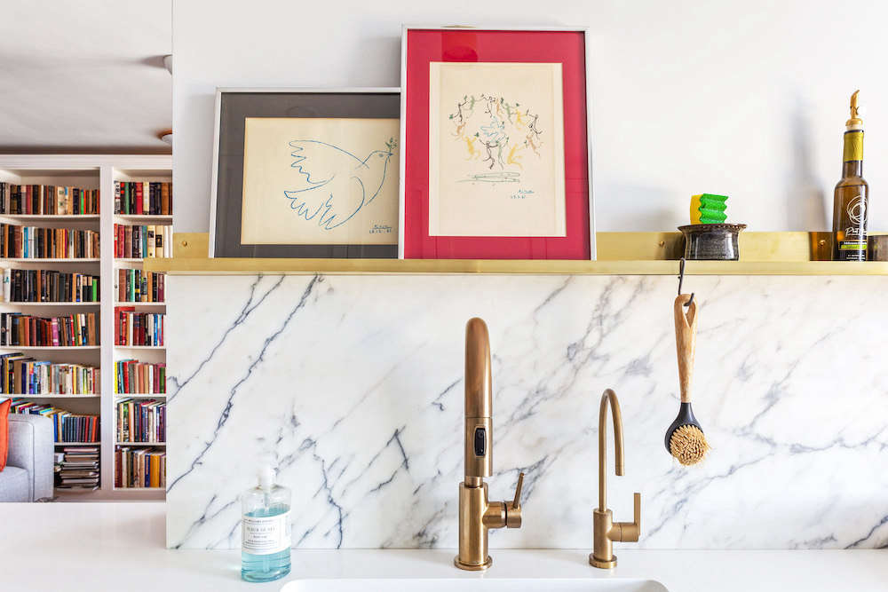 A closeup of the brass delta faucet in the Jackson Heights renovation.