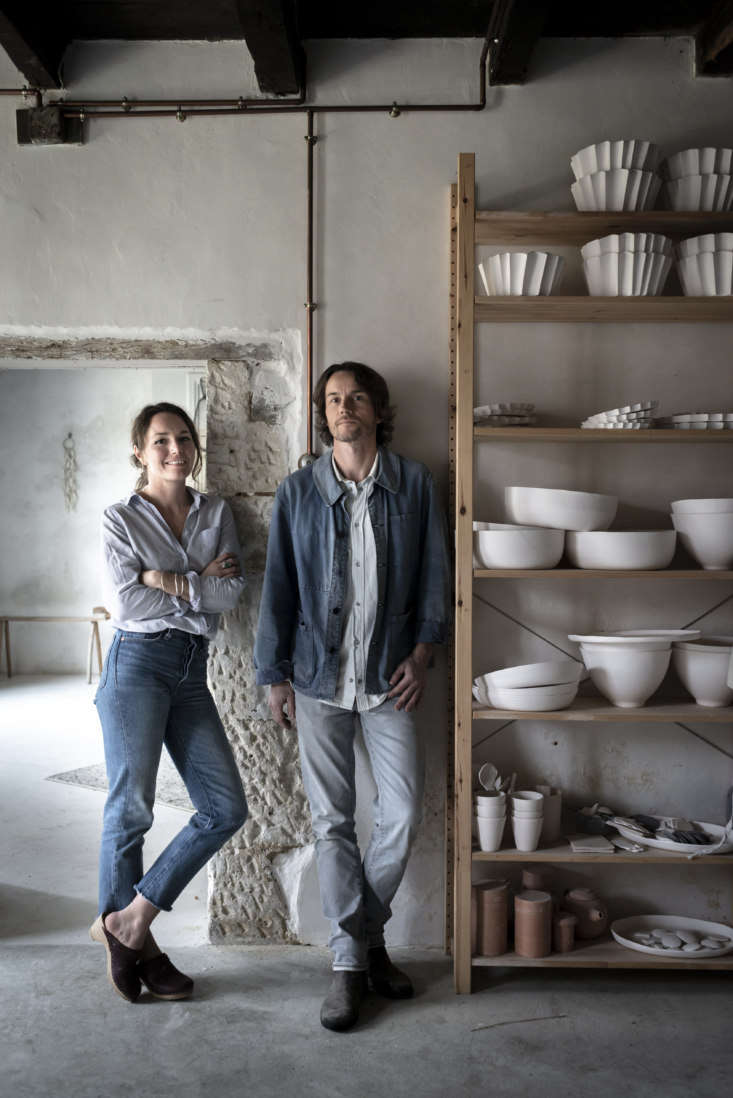 Justine and Jean in their glazing room, newly plastered by Justine&#8