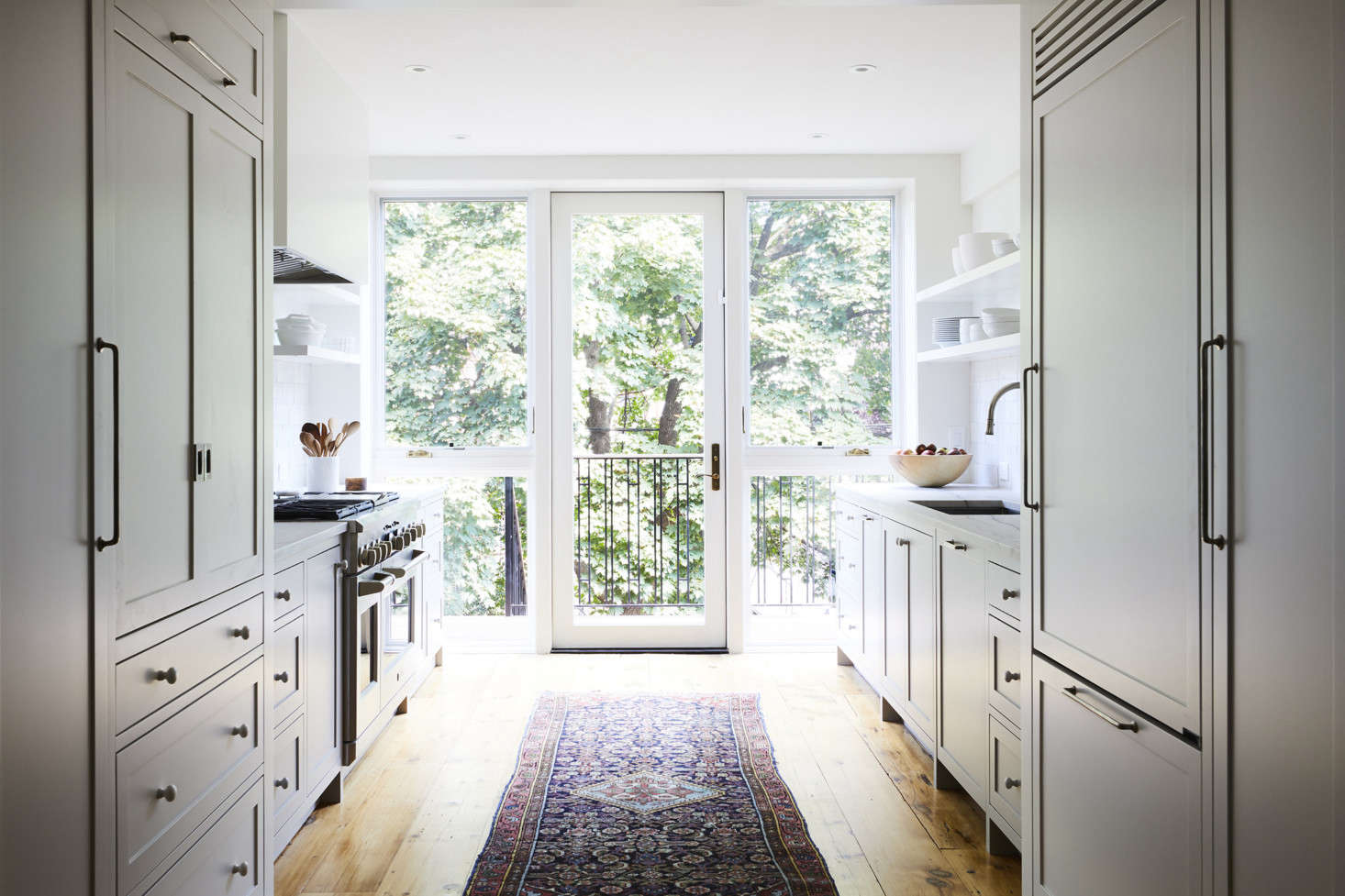 To separate the new .5-foot-wide kitchen and provide plenty of storage, Bangia and Agostinho designed a &#8