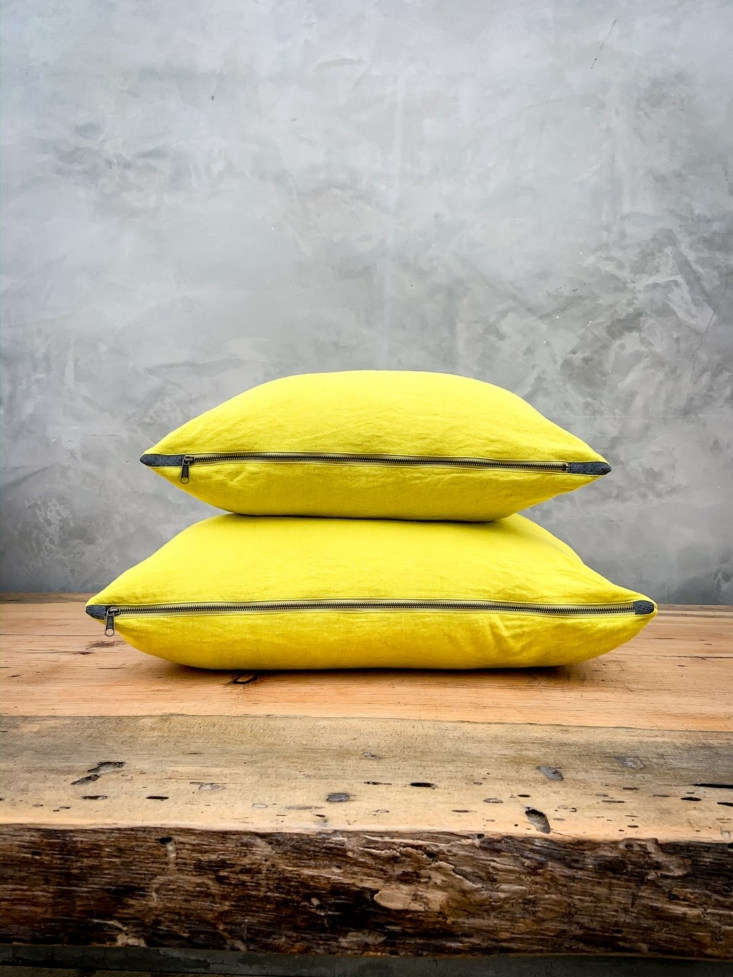 The Linen Throw Pillow is available in seven different colors and two sizes (small is  inches and large is  inches). Pictured here are both sizes in the Zesty Lemon color. All pillows are made of deadstock remnant linen; $70 to $90