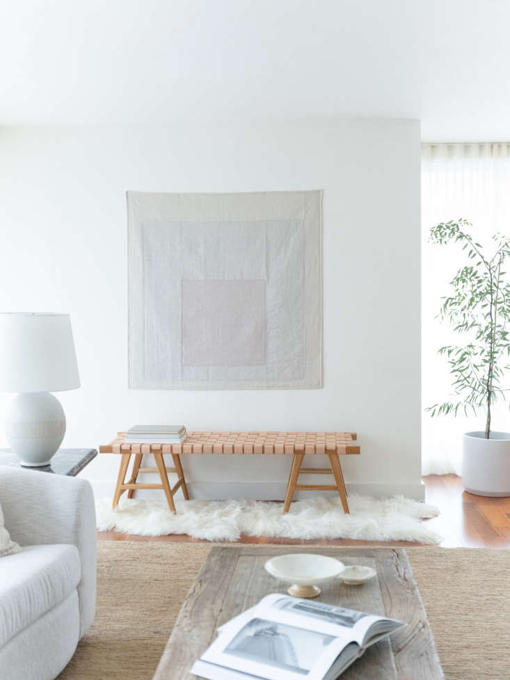 A shades-of-white wall tapestry hangs in the living area of a Seattle apartment by interior designer Lisa Staton.  See more in Design Sleuth: A Quilt Inspired by a Beloved Abstract Painting.