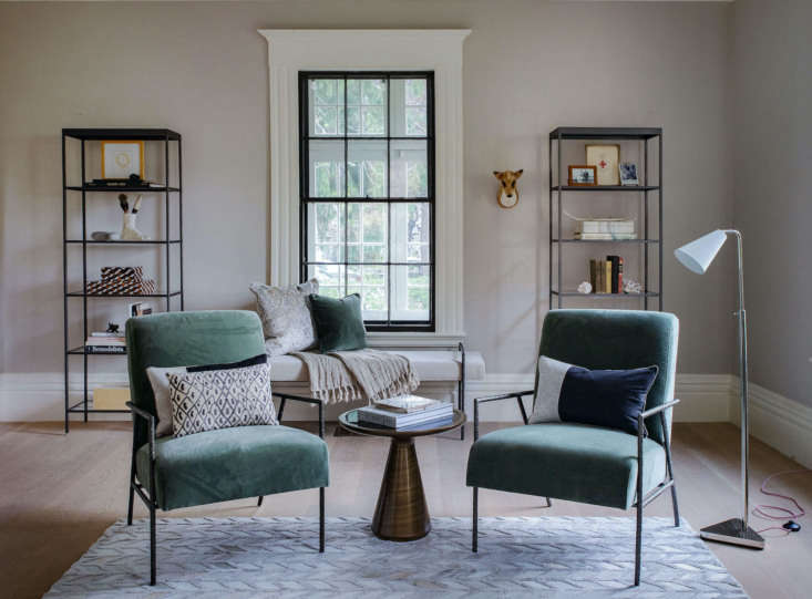 facing the sofa are two yves chairs, each with a hand forged wrought iron frame 13