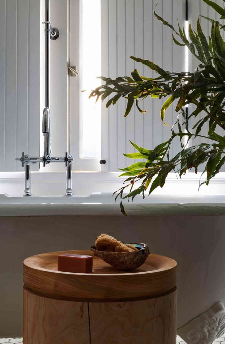 In the bathroom, a custom lathe-turned Deodar cedar trunk designed by Patrick.