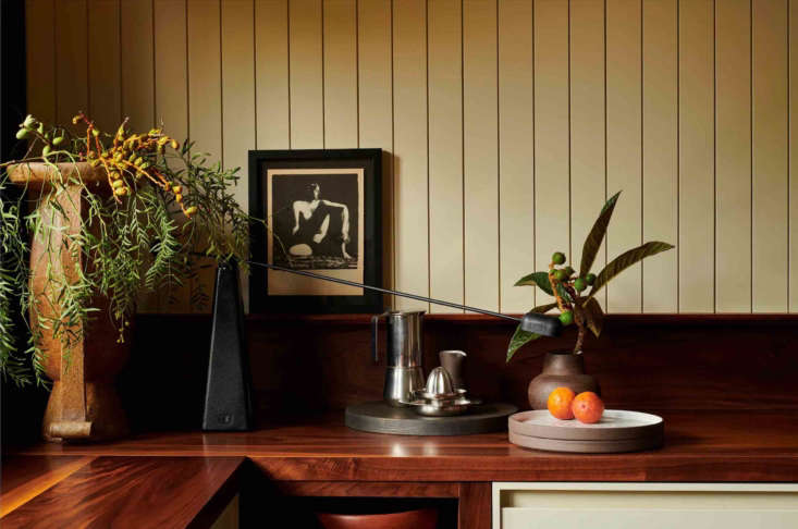The countertop is a salvaged black walnut slab with an oiled finish.