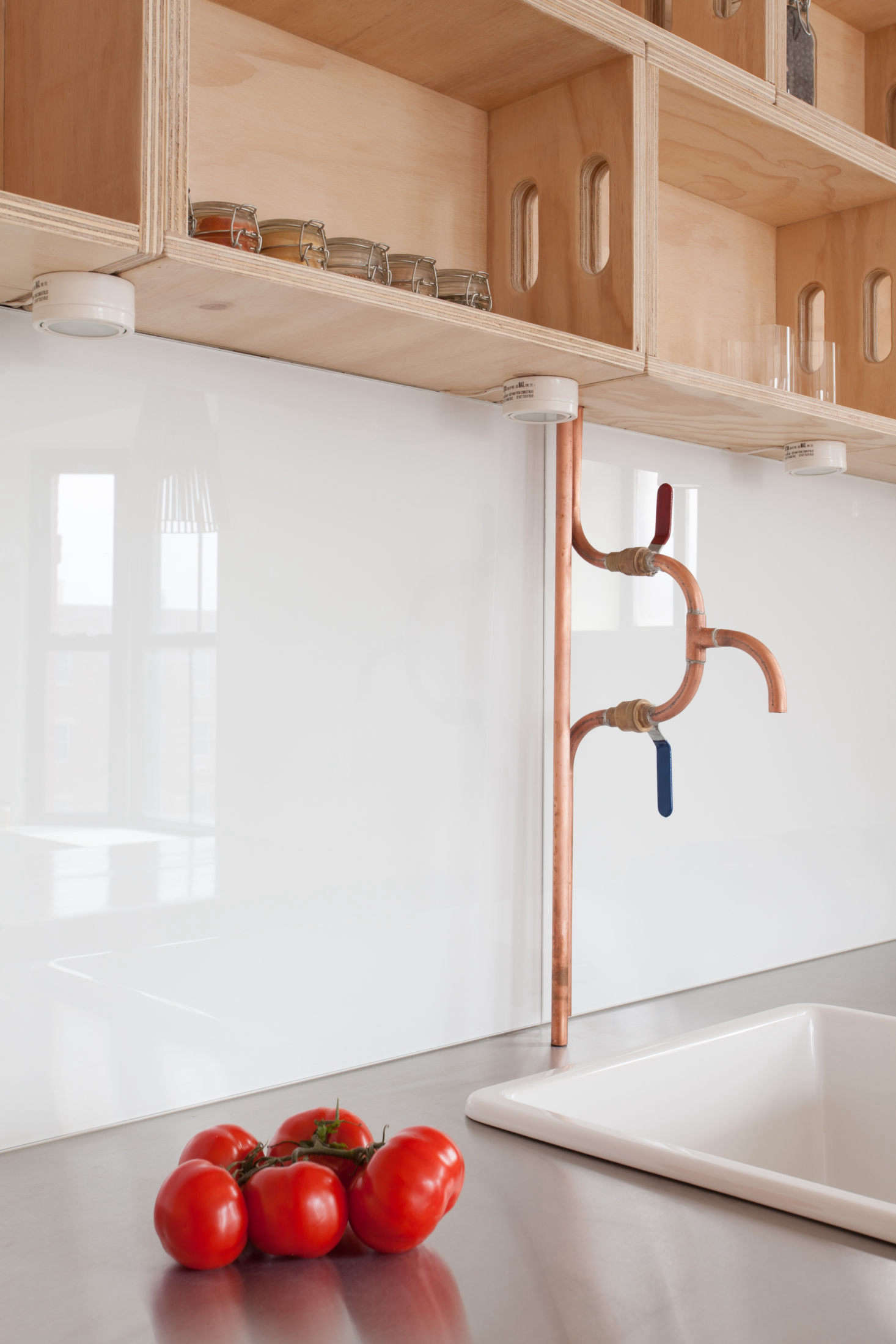 The architects had their plumber build the copper piping faucet: &#8