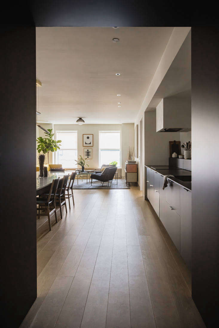 The dark mudroom opens into the bright, open living spaces, which take advantage of the light. &#8