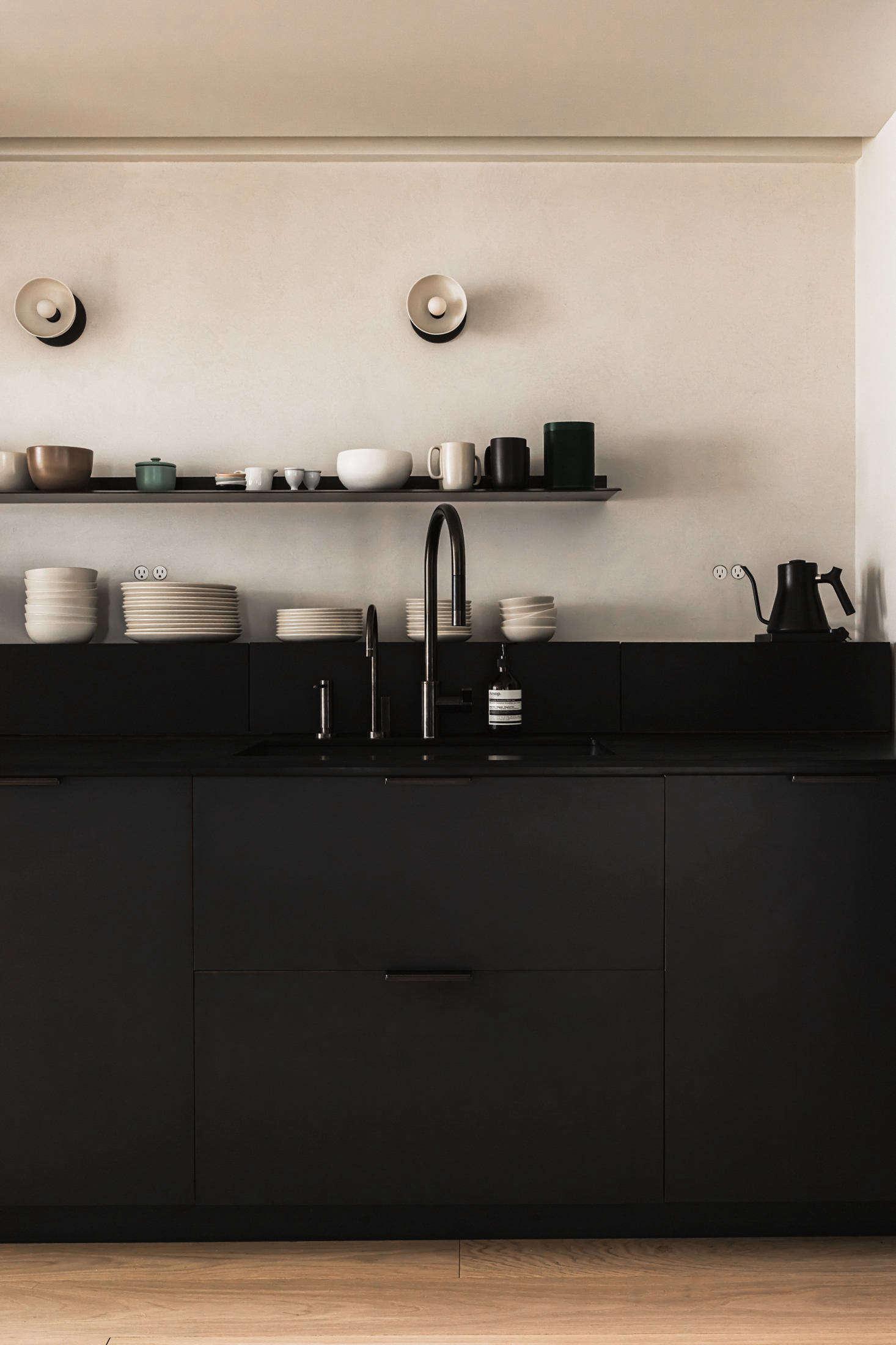 The minimal Henrybuilt kitchen in tone-on-tone black. &#8