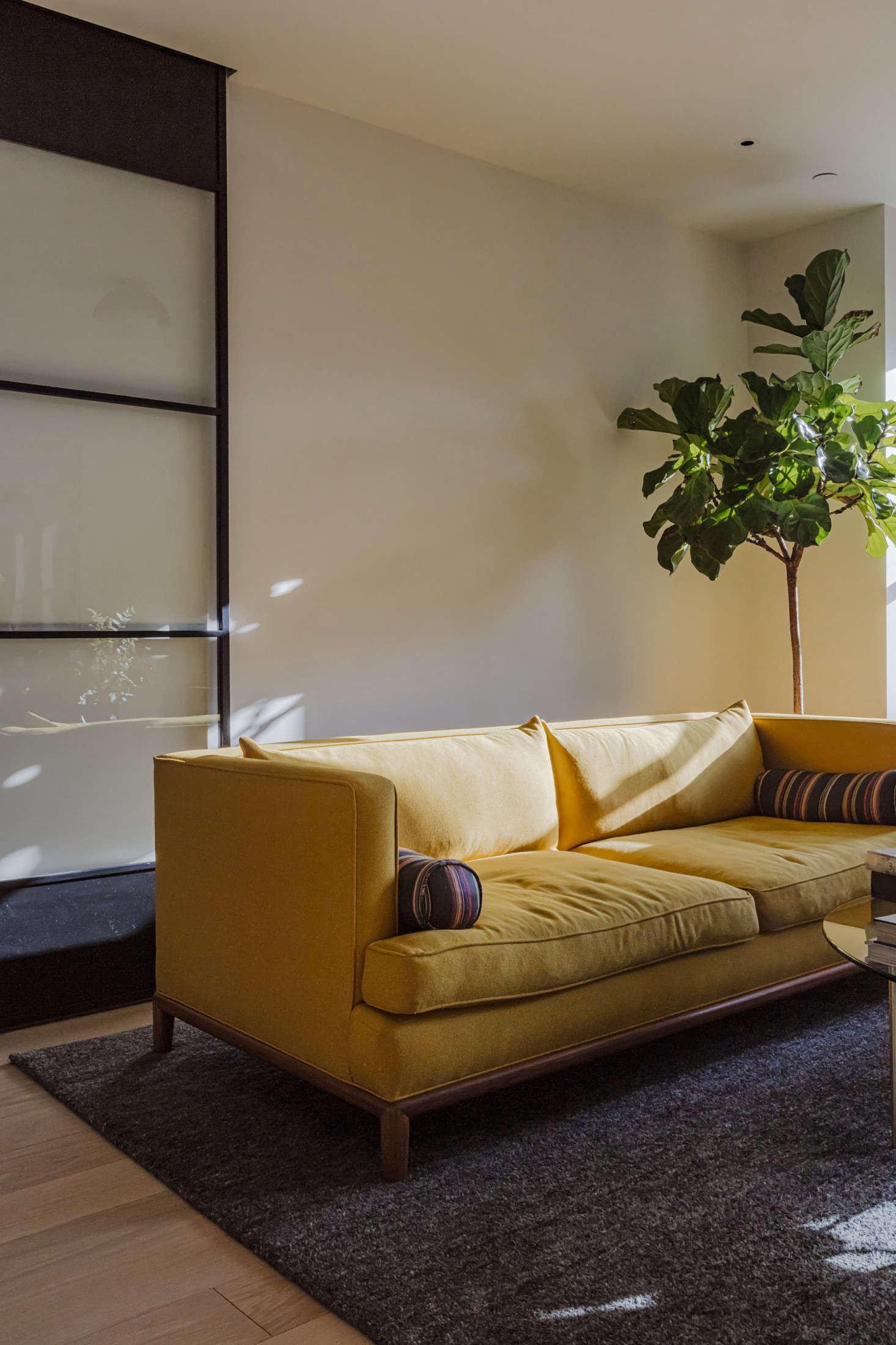 The story behind the unexpected marigold couch? Sandy, the owner, requested some color. Says Andrea: &#8