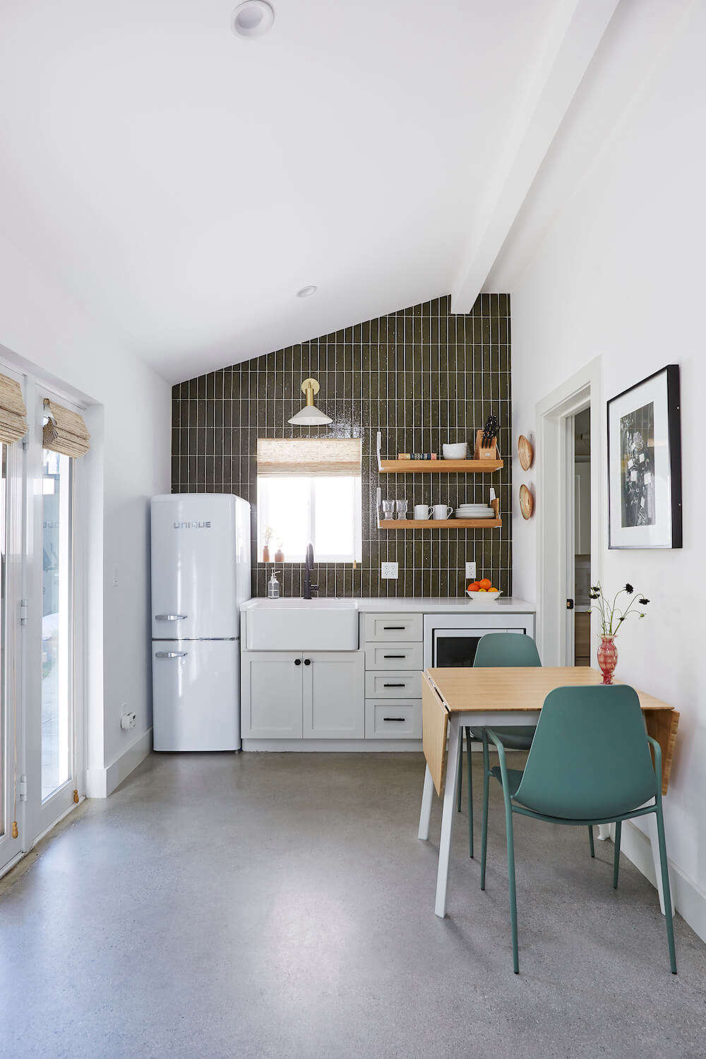 """A repurposed garage in Los Angeles for actress and producer Jaime Ray Newman. When describing the general contractor she found through Sweeten, Jaime says, """"What I liked most about the one we hired was that he had style. His taste was always on point.&#8"""