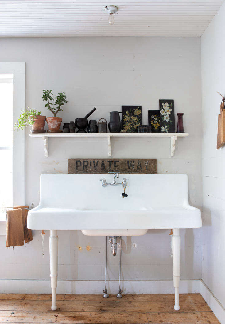 A freestanding sink in the Hamden kitchen of photographers Andrea Gentl and Martin Hyers, with hints of the couple&#8