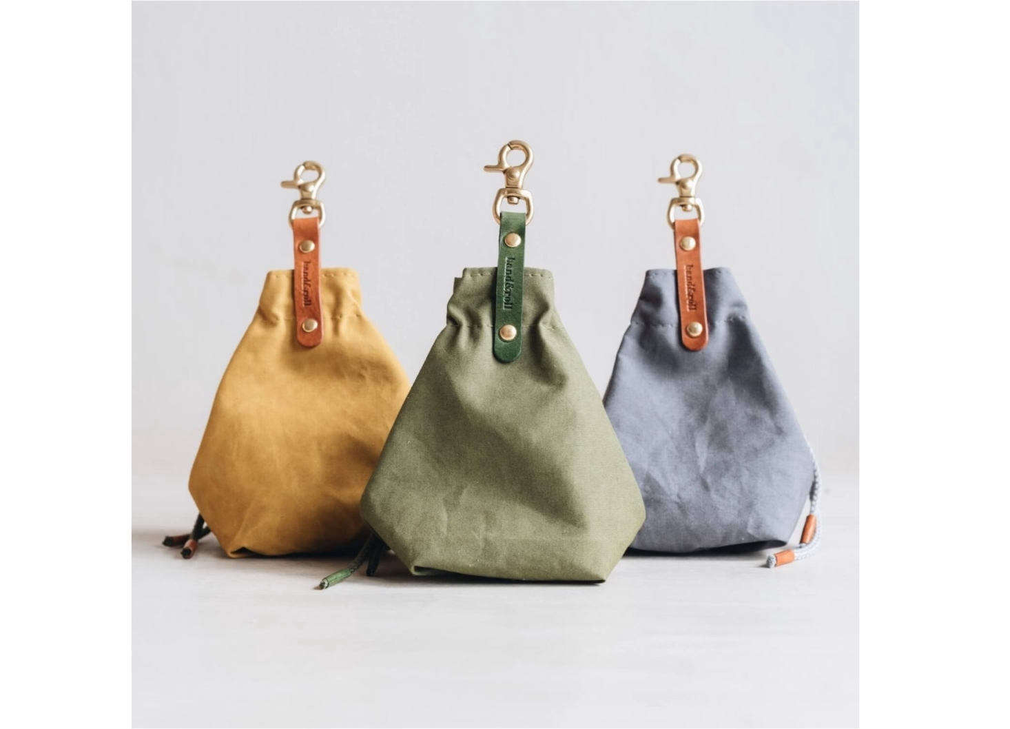 This waxed canvas Treat Bag for dogs is handmade in Berlin by Band & Roll. It holds wet and dry treats, has a cotton cord for closure, and can be clipped onto a dog leash or belt loop for easy access on walks; £35.95.