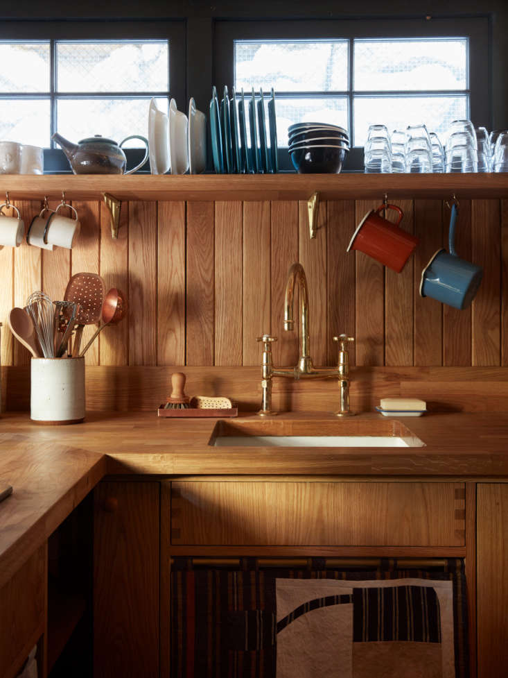 another take: wood paneling as backsplash, as seen in a hollywood director's  18