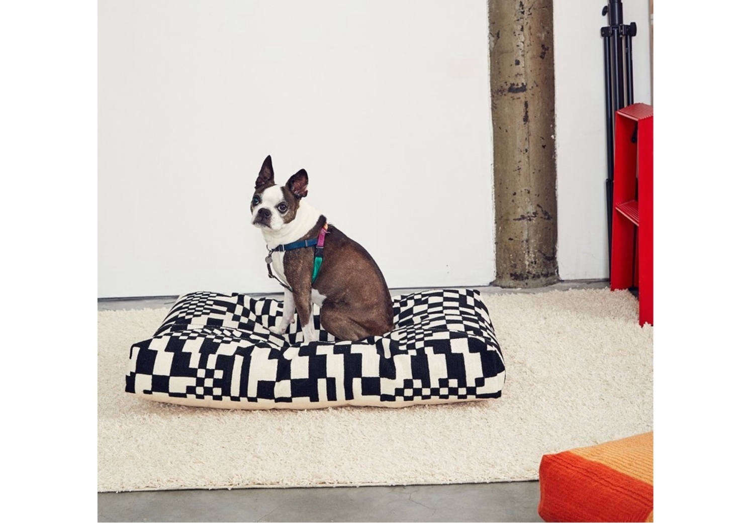 The Check Dog Bed from NYC brand Dusen Dusen has a black and white printed cotton canvas shell with wool blend embroidery throughout. It&#8