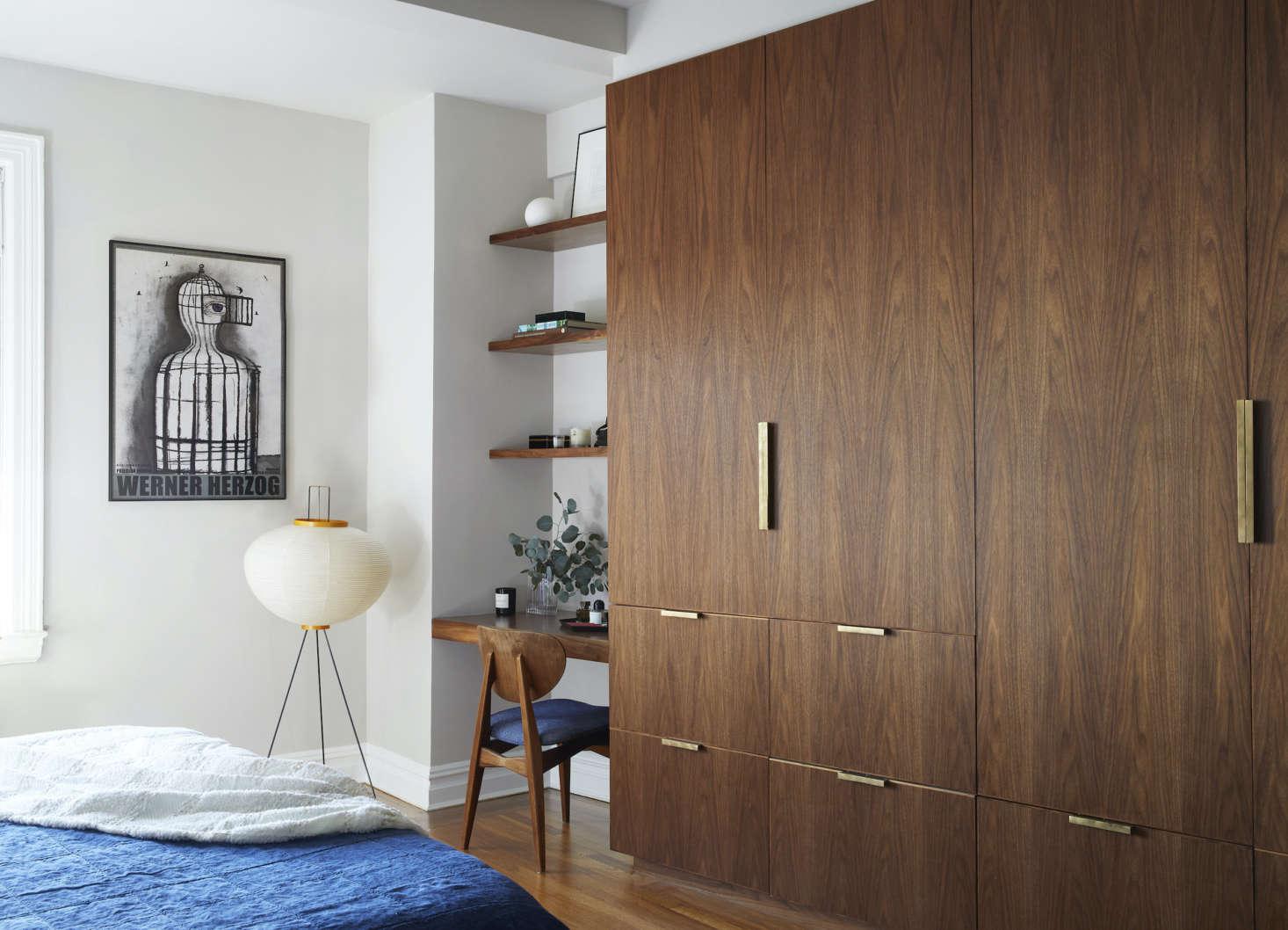 The firm designed the custom walnut closets. The floor lamp is a Noguchi. (Seesrc=