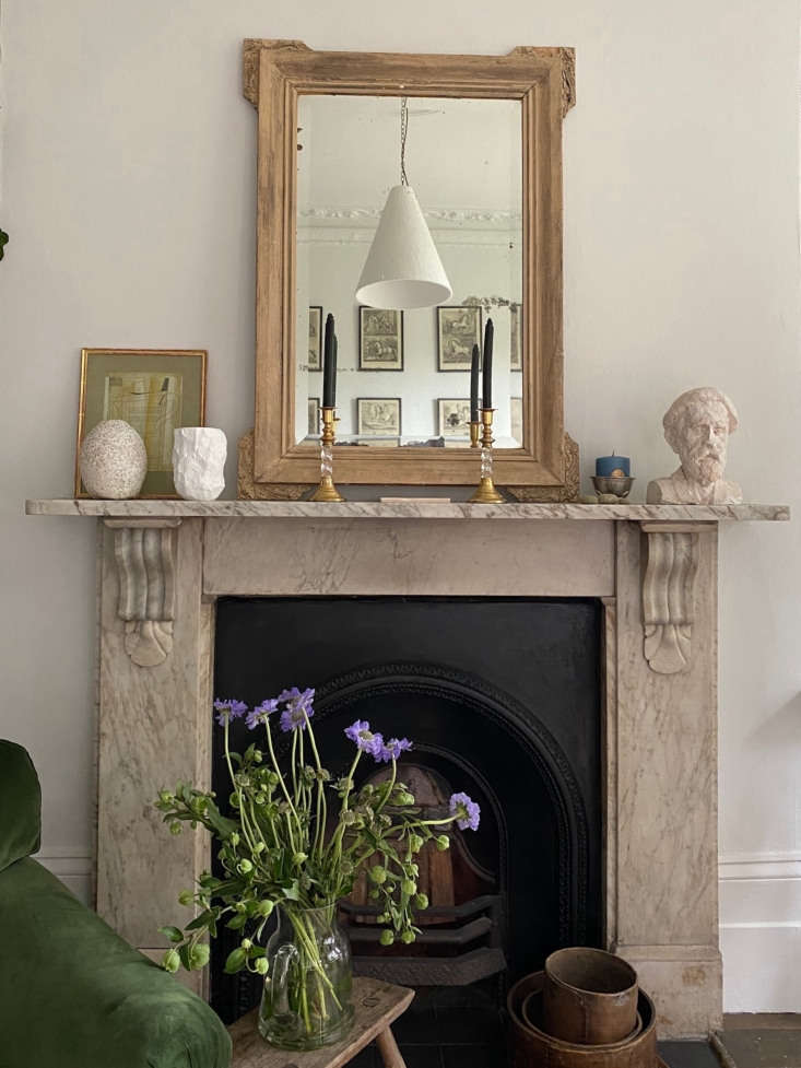 Georgie painted the walls Farrow & Ball Strong White. Reflected in the mirror is a pendant light by Rose Uniacke, where she worked as a production assistant for three years.