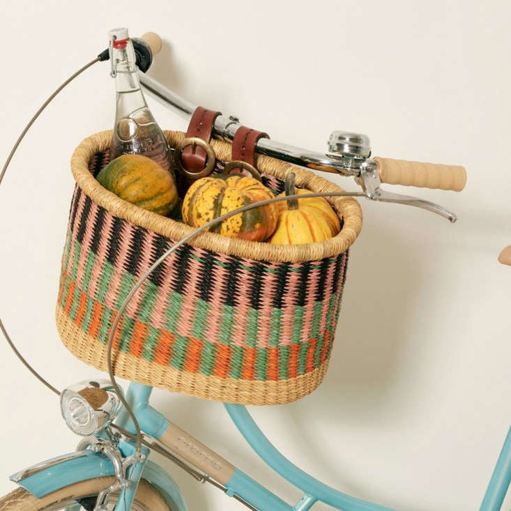 Handwoven in Ghana, the Baba Tree Large Multicolor Bicycle Basket, $95, is one of several available in different patterns and sizes from fair-trade global marketplace Goodee.