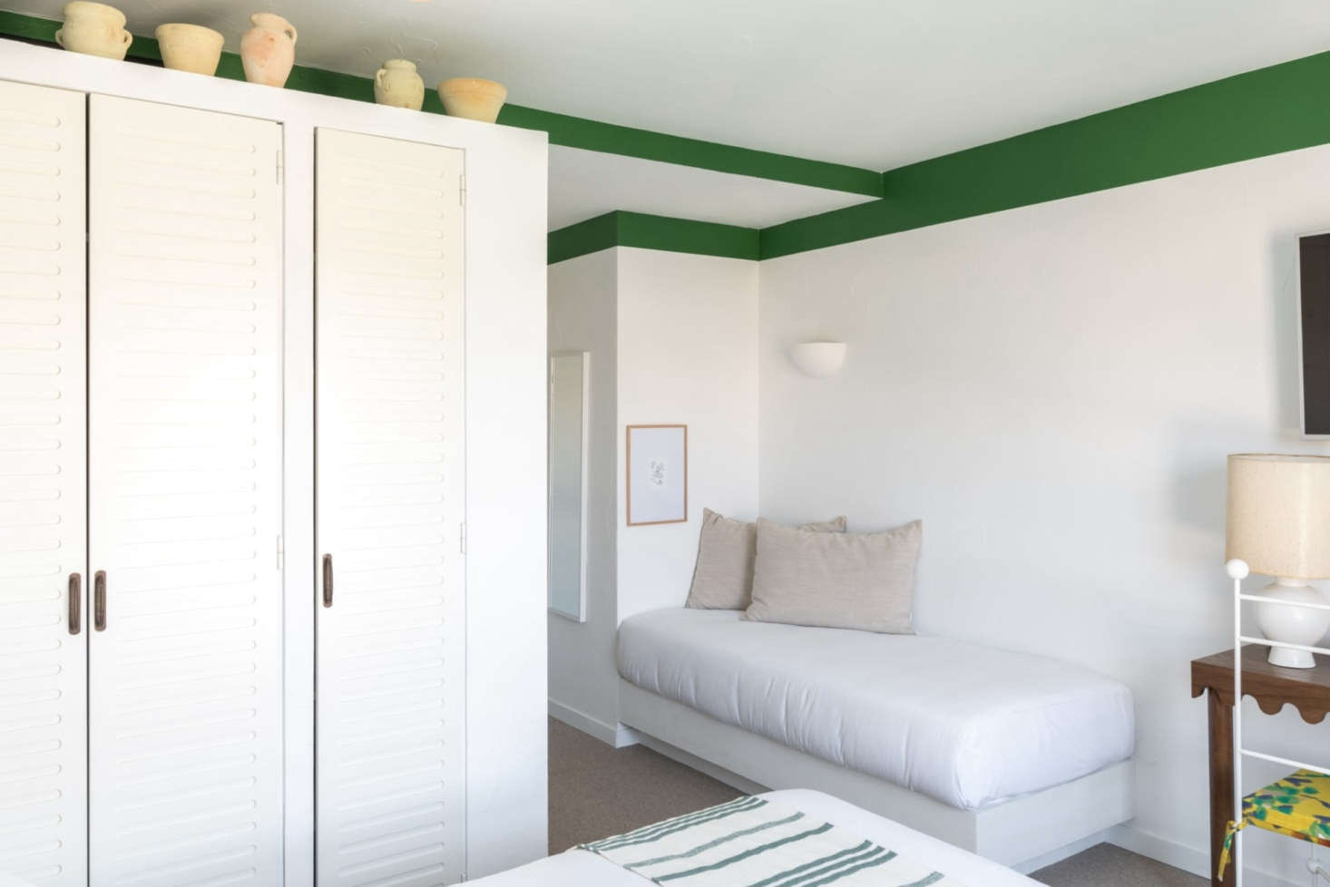 Bedrooms are simple and airy with ceramics as decor.