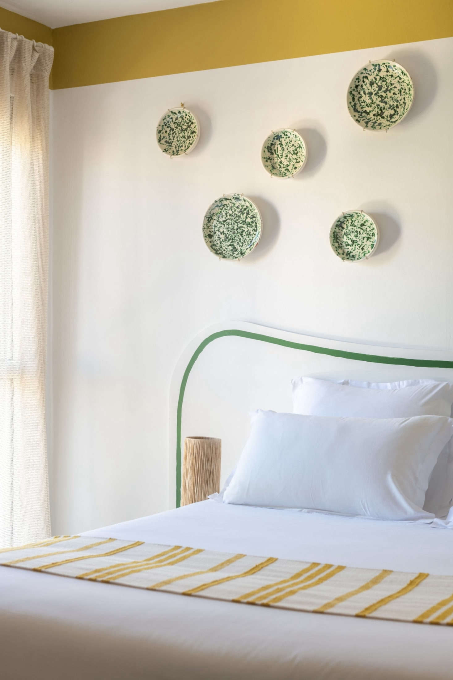 A collection of spatterware plates adds a dash of color to one of the bedrooms.
