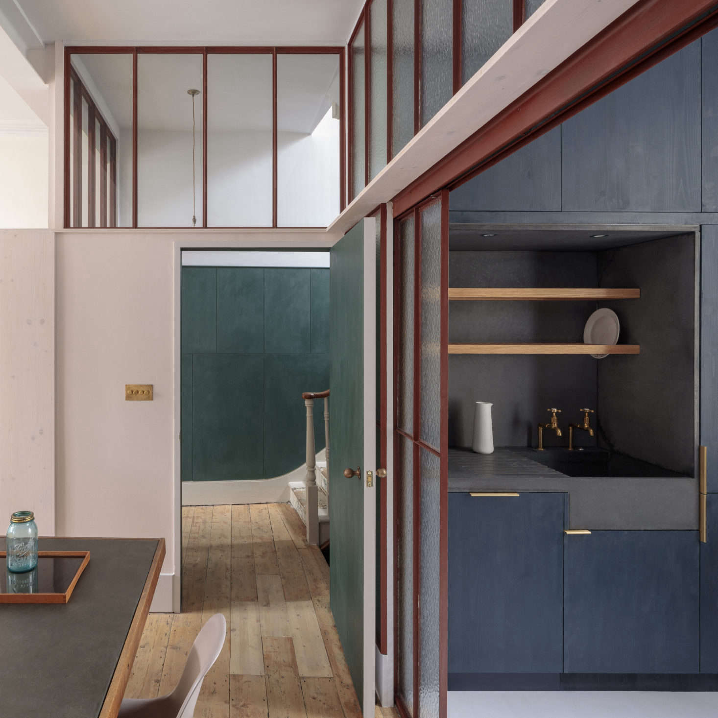 The kitchen sink and surrounding niche are all a single piece of Kast cast concrete with an overhead drying shelf. &#8