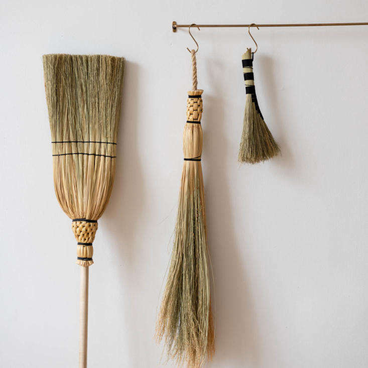 The Traditional Handmade Corn Broom(left) is handmade from corn husks, and the head of the broom is stitched flat, Shaker style. The brooms are made to last and meant to be handed down.