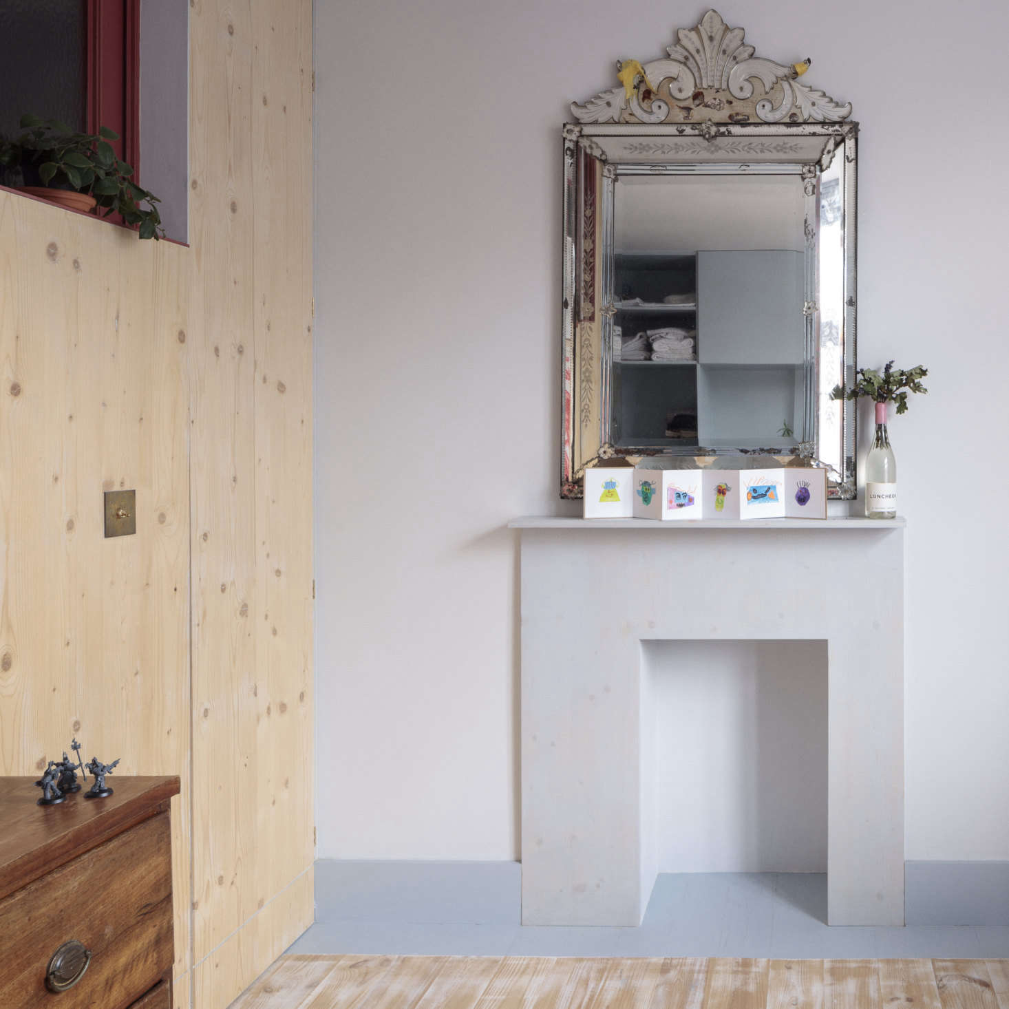The same plywood was used to create a modernist mantel for an opened up (but not functioning) old fireplace. It&#8