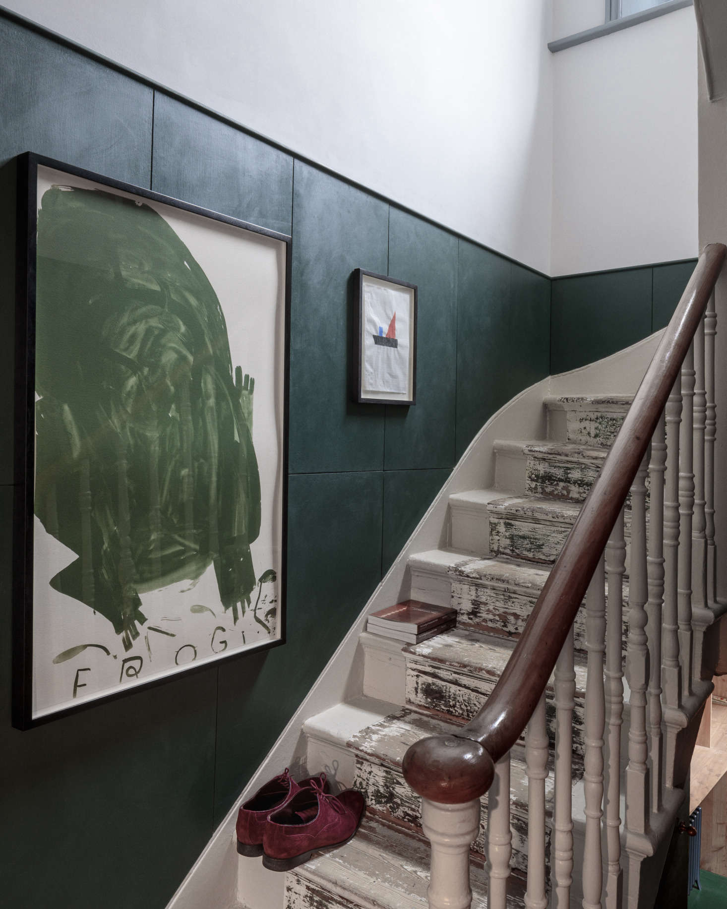 The staircase was artfully preserved—with its old runner removed and the remaining footprint left as is, but the sides of the steps were carefully repainted. What the architects describe as &#8