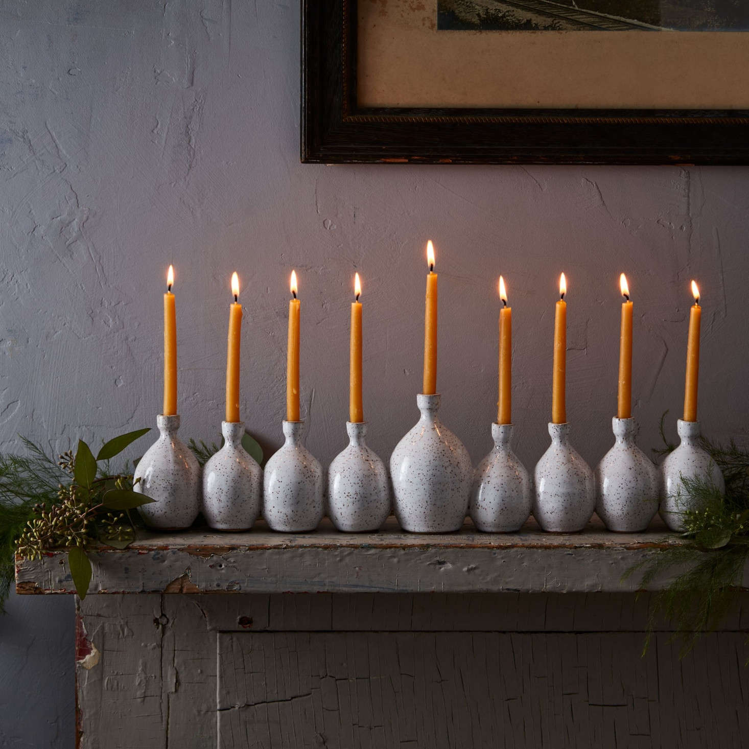 Brooklyn ceramic artist Rachel Pots attaches nine hand-thrown vases together to form her signature menorahs. &#8