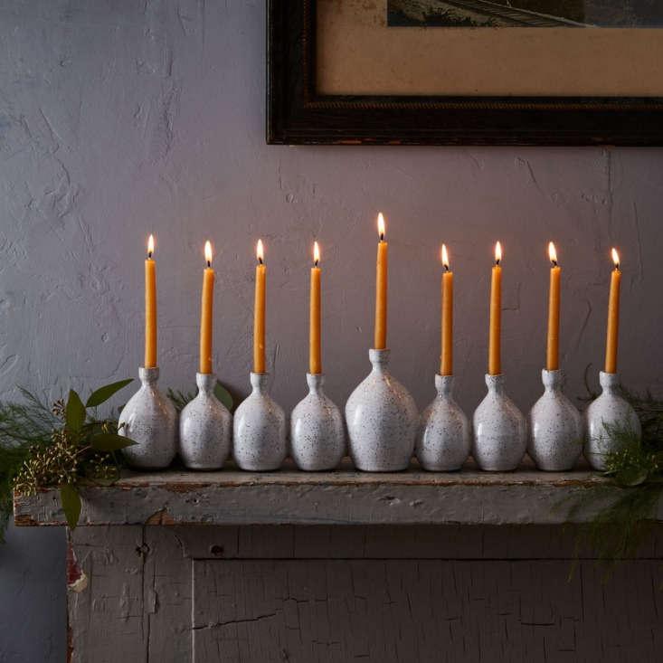 Brooklyn ceramic artist Rachel Pots attaches nine hand-thrown vases together to form her signature menorahs. &#8