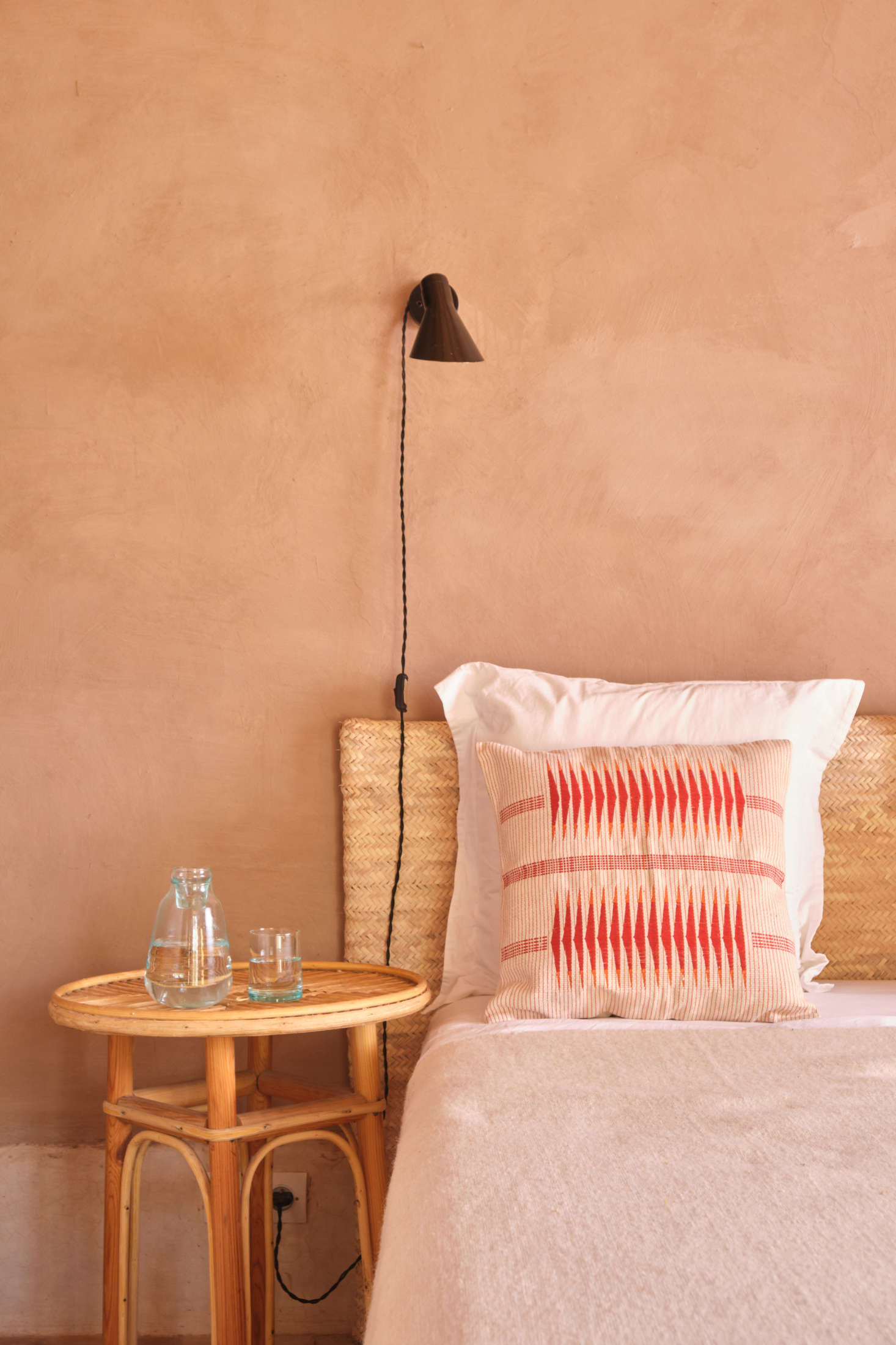 The new Milak Cushion ($99) is made from 0 percent cotton and handwoven in Nagaland on loin and backstrap looms by heritage weavers. Alongside is the Moroccan Bedside Carafe ($39), made of recycled glass, with a lid that conveniently doubles as a bedside drinking glass.