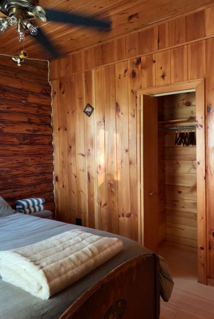 Before, the bedrooms were paneled in pine on pine.