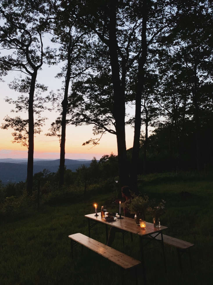A setup for simple outdoor dinners at the cabin, looking out at the valley below.