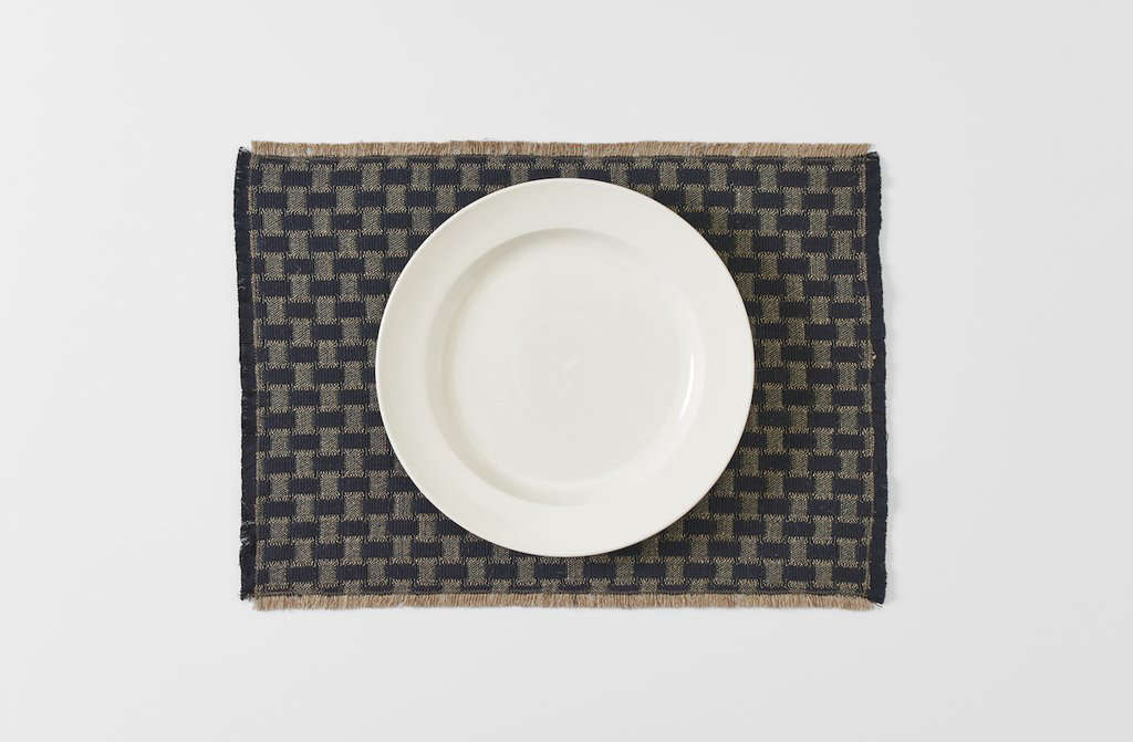 The naturally dyed Londra Black Fringed Placemat is made of cotton and hemp by Italian company Arcolaio; available in black and cream for $58 each at March SF.