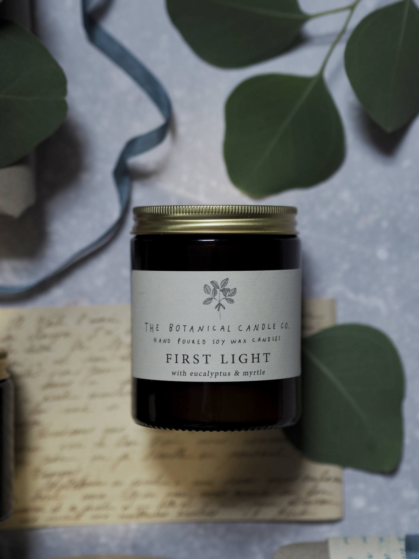 I also love the idea of these candles by UK-based Botanical Candle Co.: one for lighting early in the morning—First Light, shown here, with notes of eucalyptus and myrtle, another for lighting &#8