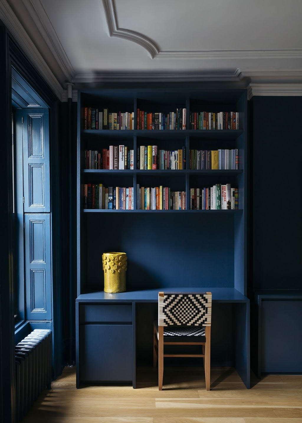 The built-ins, walls, even the shutters are all painted in Farrow & Ball's Hague Blue &#8