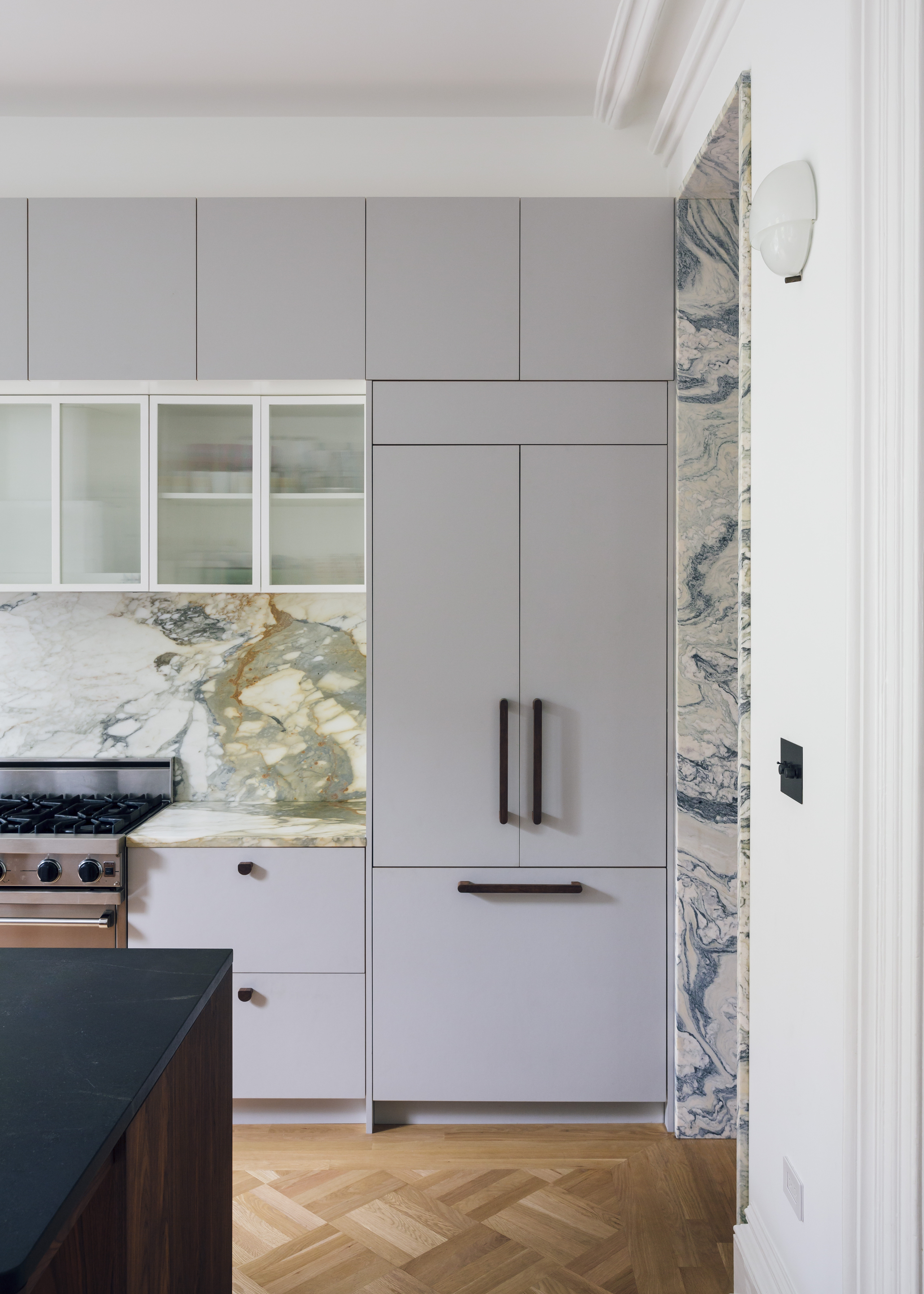 the kitchen is kept neat thanks to tucked away appliances, like an integrated r 14
