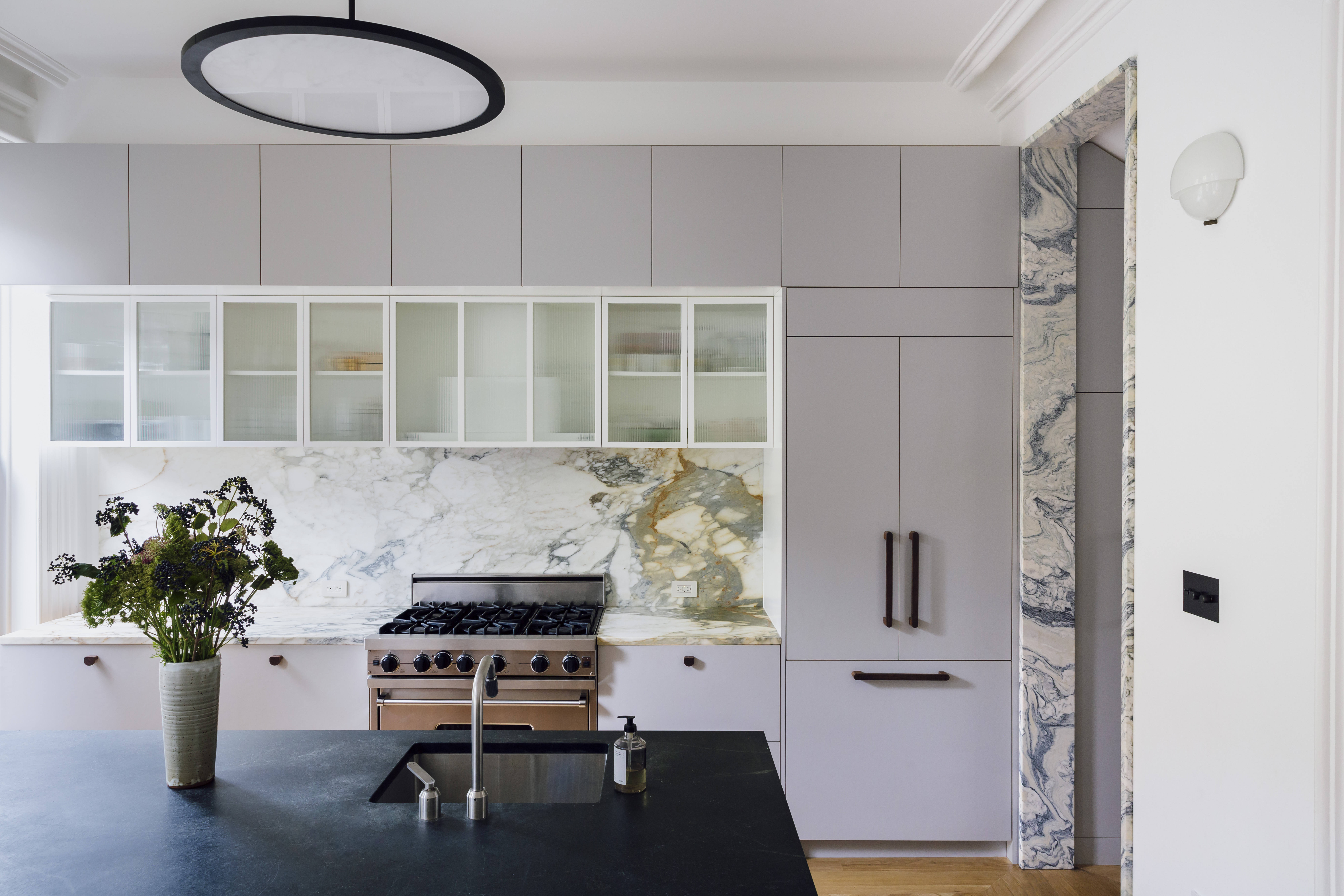 the bright, open kitchen. note the green toned marble on the doorjamb, an archi 12