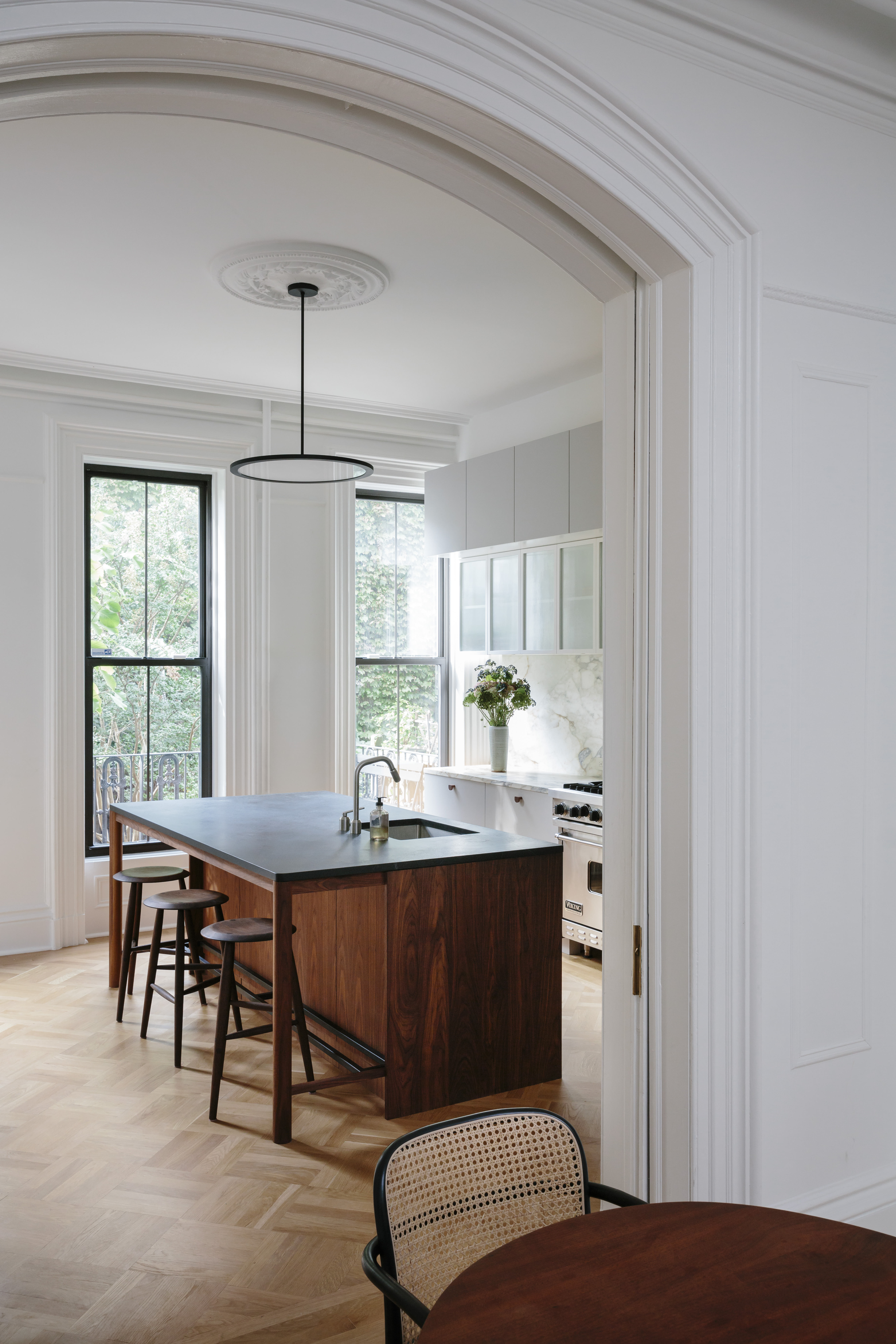 into the kitchen. the caned dining chairs are the hoffmann dining chairs by des 10