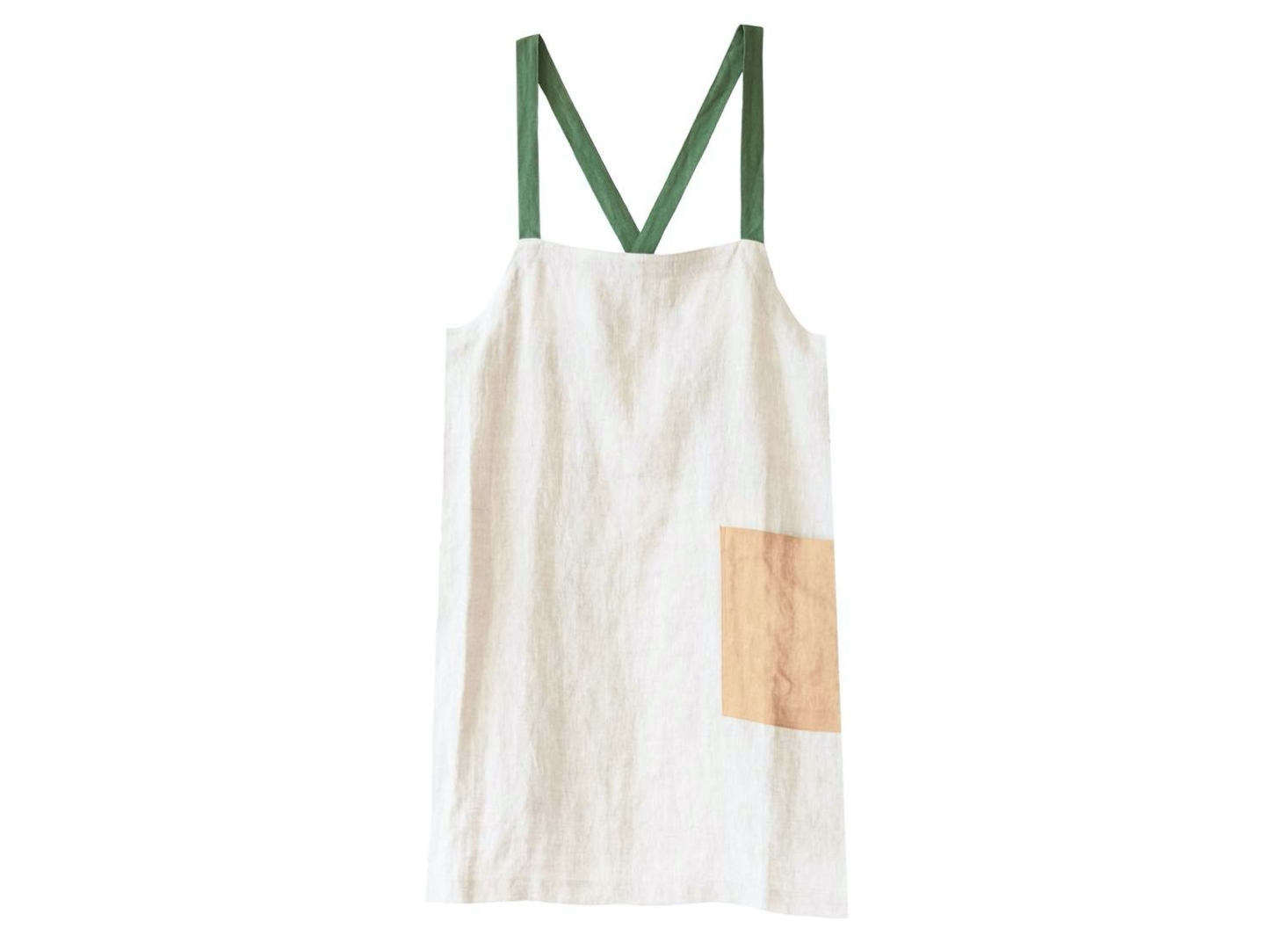 The Criss Cross Brooklyn Fit Apron by Pillowpia is made of stonewashed linen. The apron is available in solid colors for $88 and in multicolored (with a large patch pocket) for $98.