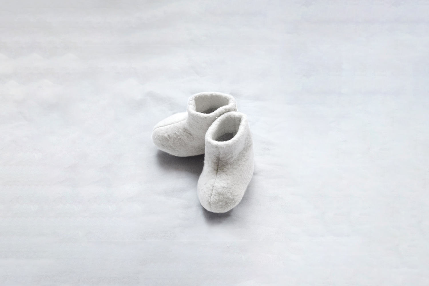 The Newborn Cotton Booties are the sort of booties that actually stay on a baby&#8