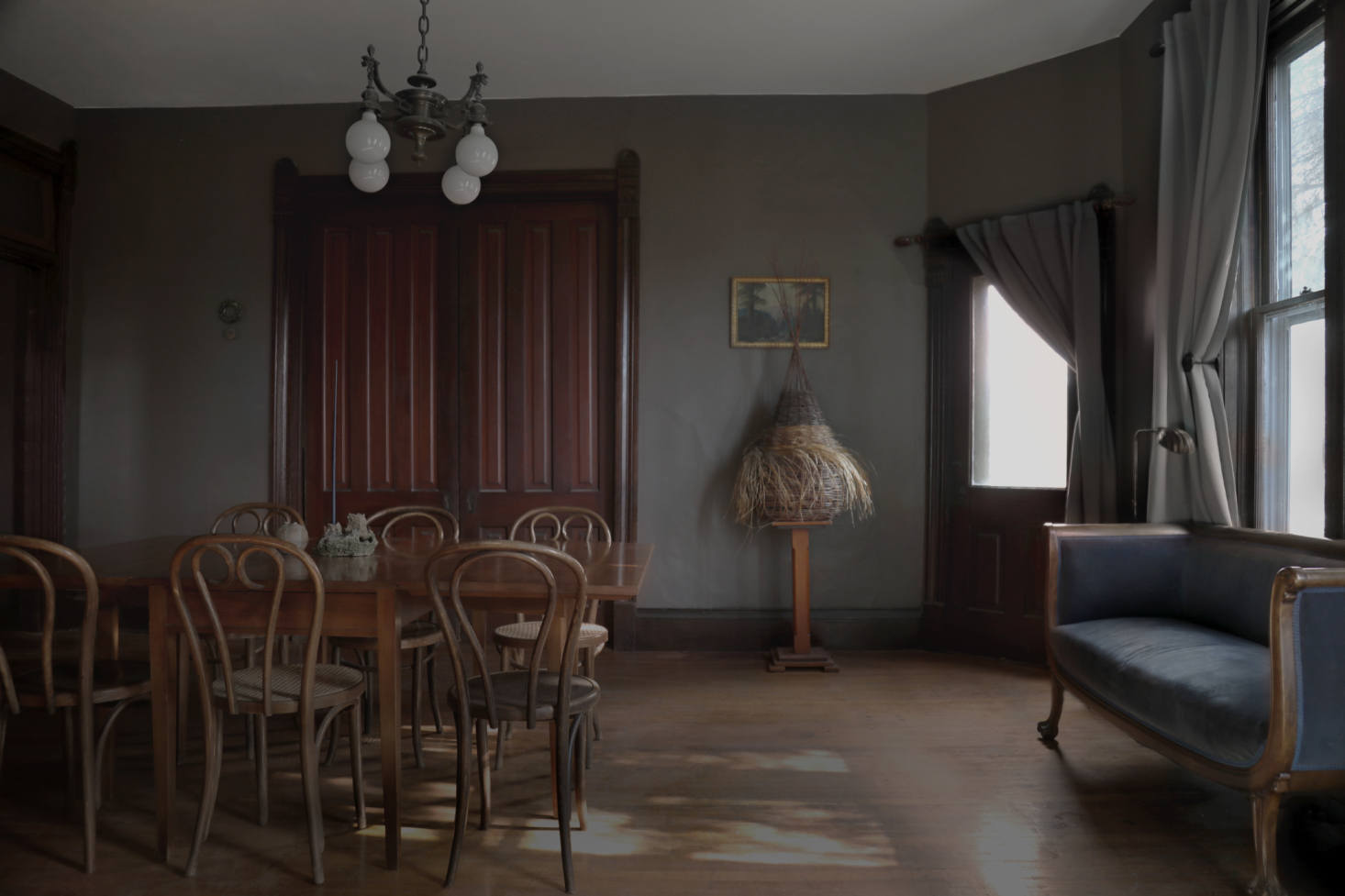 The dark-hued dining area. On a pedestal is &#8
