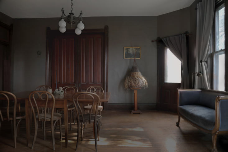 the dark hued dining area. on a pedestal is &#8\2\20;an unfinished willow b 12