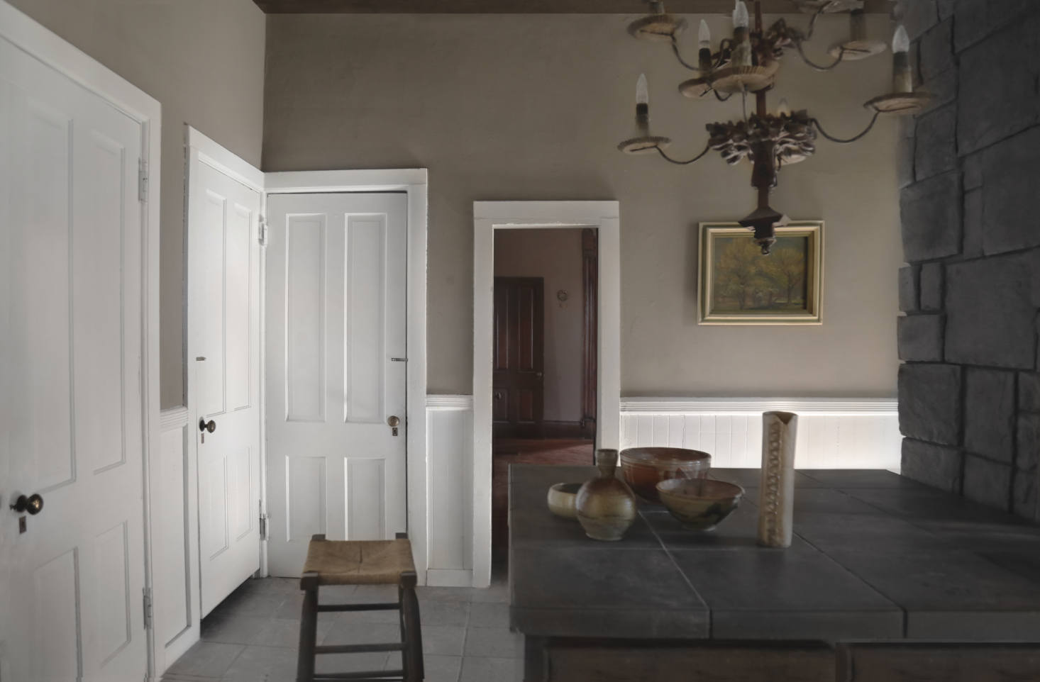 The cookspace has a stone hearth and original doors and is painted in Sherwin Williams&#8