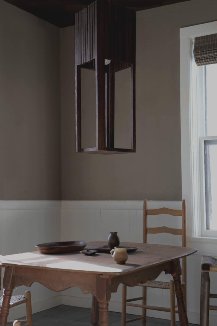 a breakfast table beneath a sculptural light fixture. 16