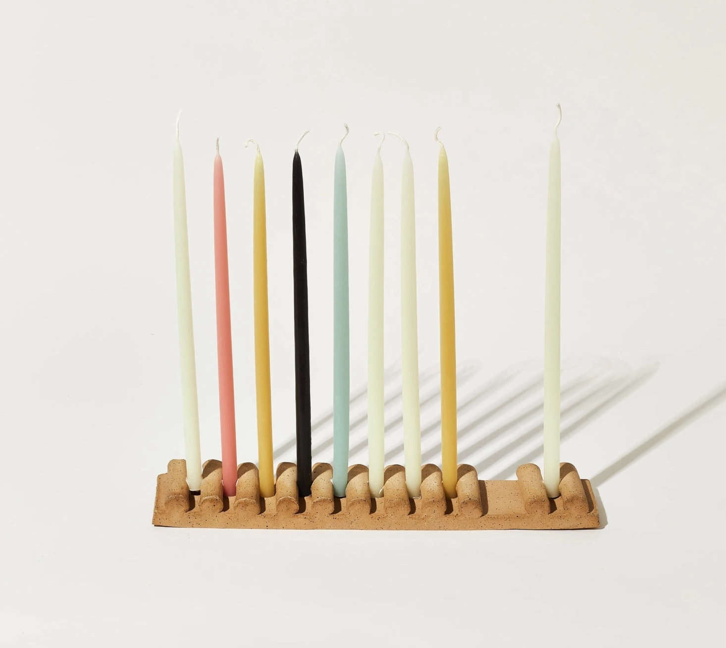 Ceramic artist Virginia Sin describes her new Stacke Menorah, $src=