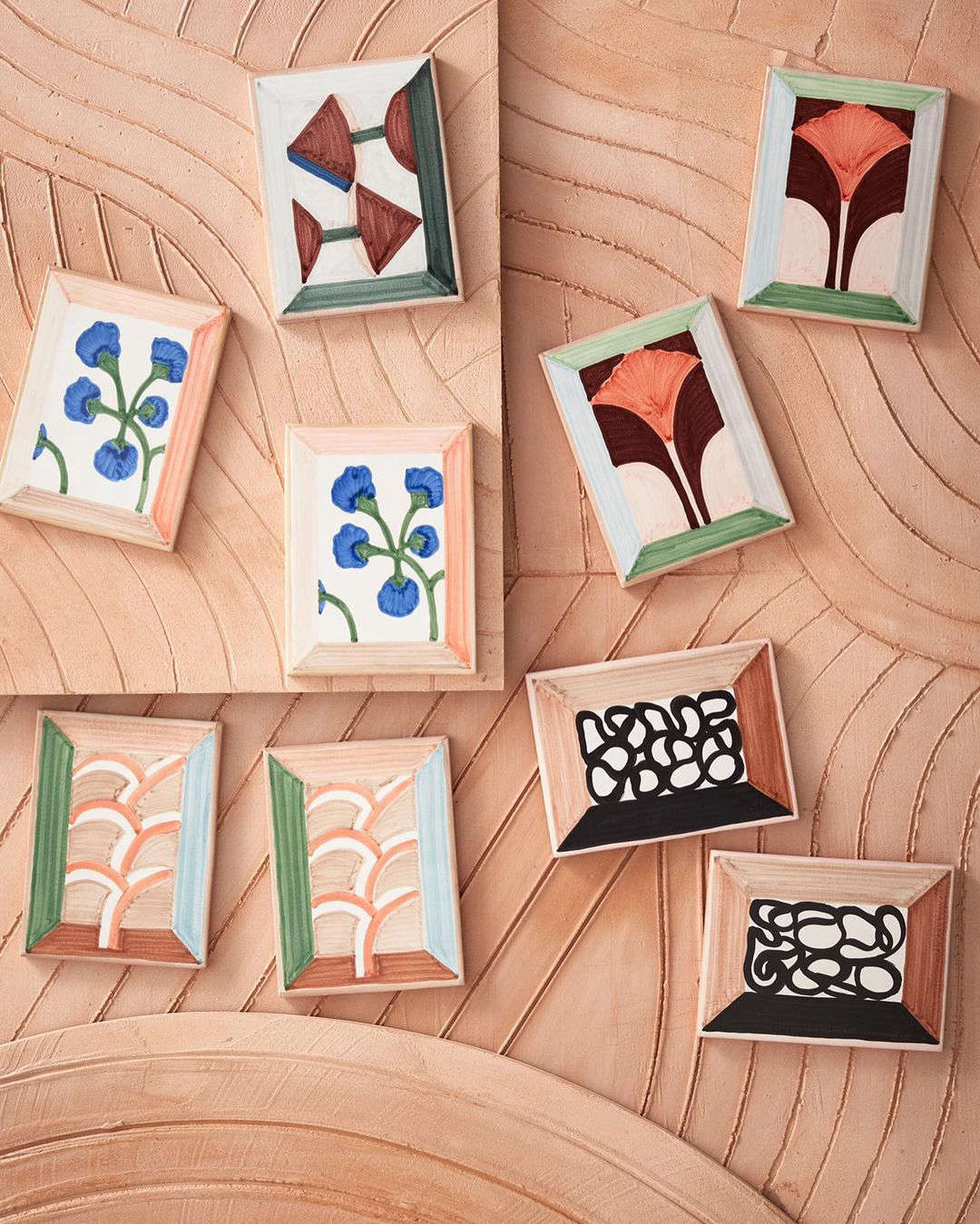 Frames incorporated into the designs make the tiles look like canvases. &#8