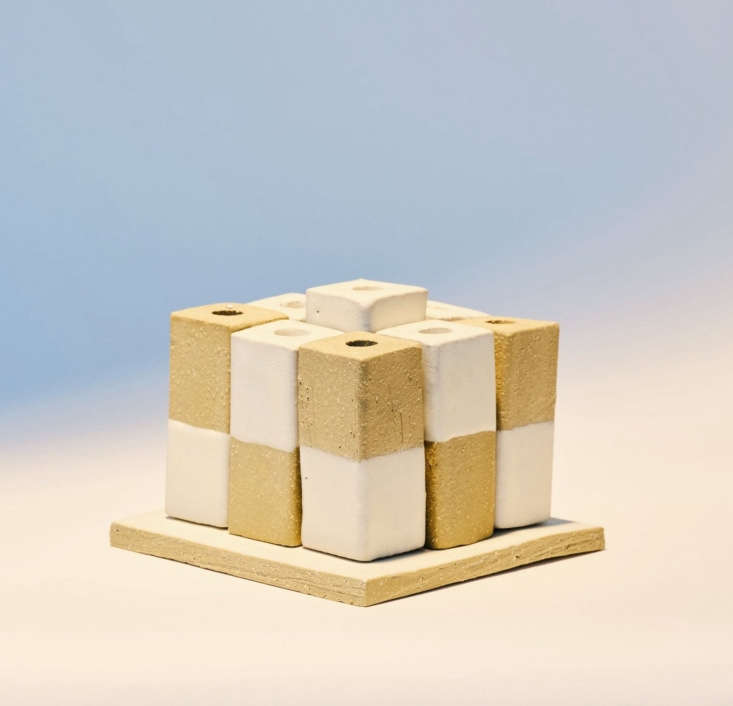 The modular stoneware JST B. Zippy Menorah, $0, can be arranged in different patterns in a cluster or a row. Made by Bari Ziperstein, it&#8